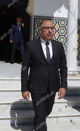 Stock Photo of Tunisia's Prime Minister-designate Hichem Mechichi before consultations as part of the formation of the next government in Tunis, Tunisia, 07 August 2020. The designated head of government, Hichem Mechichi, is continuing the consultations within the framework of the formation of the next government. He will talk to the former heads of government, Hamadi Jebali, Ali Laarayedh, Habib Essid and Youssef Chahed. According to article 89 of the Constitution, the personality who will be tasked with forming the next government will have one month to train his team and present it to the Assembly of People's Representatives, the deadline of 25 August 2020.