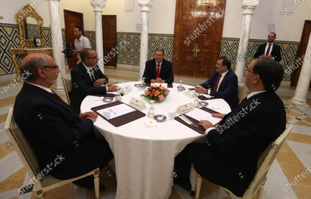 Tunisia's Prime Minister-designate Hichem Mechichi,( 2 L) with  former heads of government, Hamadi Jebali(L), Habib Essid (C) Youssef Chahed( R) Ali Laârayedh (2-R) during consultations as part of the formation of the next government in Tunis, Tunisia, 07 August 2020. The designated head of government, Hichem Mechichi, is continuing the consultations within the framework of the formation of the next government. He will talk to the former heads of government, Hamadi Jebali, Ali Laarayedh, Habib Essid and Youssef Chahed. According to article 89 of the Constitution, the personality who will be tasked with forming the next government will have one month to train his team and present it to the Assembly of People's Representatives, the deadline of 25 August 2020.