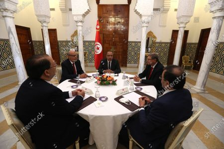 Stock Picture of Tunisia's Prime Minister-designate Hichem Mechichi,( C) with  former heads of government, Hamadi Jebali(2-L), Youssef Chahed( ( L) Ali Laârayedh (R)  Habib Essid (2-R) during consultations as part of the formation of the next government in Tunis, Tunisia, 07 August 2020. The designated head of government, Hichem Mechichi, is continuing the consultations within the framework of the formation of the next government. He will talk to the former heads of government, Hamadi Jebali, Ali Laarayedh, Habib Essid and Youssef Chahed. According to article 89 of the Constitution, the personality who will be tasked with forming the next government will have one month to train his team and present it to the Assembly of People's Representatives, the deadline of 25 August 2020.