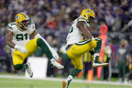 Green Bay Packers outside linebacker Za'Darius Smith, right, celebrates with teammate Preston Smith after sacking Minnesota Vikings quarterback Kirk Cousins during the second half of an NFL football game in Minneapolis. Za'Darius Smith and Preston Smith aren't related, but the Packers pass rushers share the same last name and the same type of productive games. They combined for 25 ½ sacks last season after both signed with the Packers as free agents in early 2019