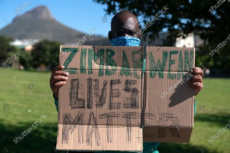 A Zimbabwean man protests against the Zimbabwe government in the streets around the consulate in Cape Town, South Africa, 07 August 2020. Zimbabweans in South Africa protested in Pretoria and Cape Town against President Emmerson Mnangagwa's government citing state corruption, human rights abuses, media restrictions and a shrinking economy.