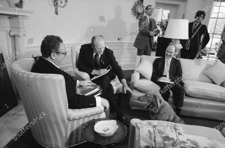 Liberty, President Gerald Ford's golden retriever, receives greetings from the President as he made an unexpected visit to the Oval Office, at the White House in Washington. Liberty dropped by while Ford was meeting with Secretary of State Henry Kissinger and Maj. Gen. Brent Scowcroft, deputy assistant for national security affairs. A longtime adviser to Presidents Gerald Ford and George H.W. Bush has died. Brent Scowcroft was 95. A spokesperson for the late President Bush says Scowcroft died Thursday of natural causes at his home in Falls Church, Virginia