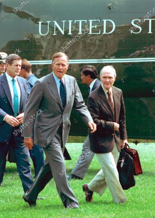President George Bush, accompanied by National Security Adviser Brent Scowcroft, right, arrives back at the White House after he interrupteed his vacation following the overthrow of Soviet President Gorbachev. A longtime adviser to Presidents Gerald Ford and George H.W. Bush has died. Brent Scowcroft was 95. A spokesperson for the late President Bush says Scowcroft died Thursday of natural causes at his home in Falls Church, Virginia