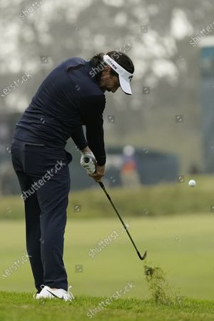 Mike Lorenzo-Vera, of France, hits from the rough on the ninth hole during the second round of the PGA Championship golf tournament at TPC Harding Park, in San Francisco