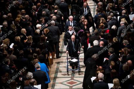 Stock Photo of In this file photo, Former national security advisor Brent Scowcroft walks out behind there casket of former president George Herbert Walker Bush down the center isle following a memorial ceremony at the National Cathedral in Washington,.