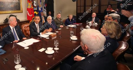In this file photo, United States President Barack Obama makes a statement during a meeting with present administration officials and former Secrtaries of State and Defense in the Roosevelt Room of the White House. From left to right: US Vice President Joseph Biden; President Obama; Henry Kissinger, former US Secretary of State; General James Cartwright, Vice Chairman Joint Chiefs of Staff; Madeleine Albright, former Secretary of State; Brent Scowcroft, former National Security Advisor; US Senator John Kerry (Democrat of Massachusetts); US Secretary of State Hillary Rodham Clinton; and US Senator Richard Lugar (Republican of Indiana) .