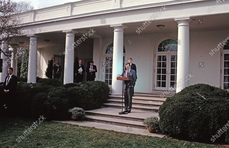 In this file photo, United States President George H.W. Bush reads a statement rejecting the proposed Soviet peace agreement to end the Gulf War with Iraq in the Rose Garden of the White House in Washington, D.C.. Also visible in the photo are White House Press Secretary Marlin Fitzwater, National Security Advisor Brent Scowcroft, White House Chief of Staff John Sununu, and U.S. Vice President Dan Quayle.