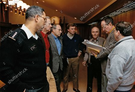 In this file photo, United States President George H.W. Bush receives a briefing at Camp David, the Presidential retreat near Thurmont, Maryland by National Security advisors on the status of the Gulf conflict. From left to right: US Army General Colin Powell, Chairman of the Joint Chiefs of Staff; US Secretary of State James A. Baker III; US Secretary of Defense Dick Cheney; US Vice President Dan Quayle; National Security Advisor Brent Scowcroft; President Bush and White House Chief of Staff John Sununu. Mandatory