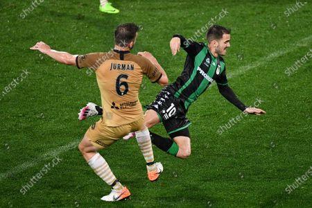 Stock Image of Western United midfielder Steven Lustica (10) trips over Western Sydney Wanderers defender Matthew Jurman (6)