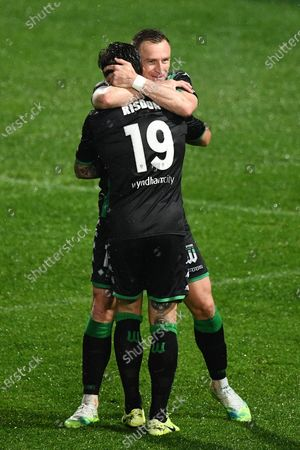 Western United forward Besart Berisha (18) celebrates his goal with Western United defender Josh Risdon (19)