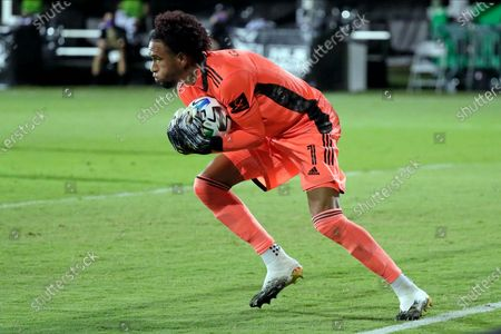 Orlando City goalkeeper Pedro Gallese (1) looks downfield after stopping a shot by Minnesota United during the second half of an MLS soccer match, in Kissimmee, Fla