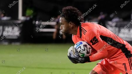 Orlando City goalkeeper Pedro Gallese looks downfield after stopping a shot by Minnesota United during the second half of an MLS soccer match, in Kissimmee, Fla