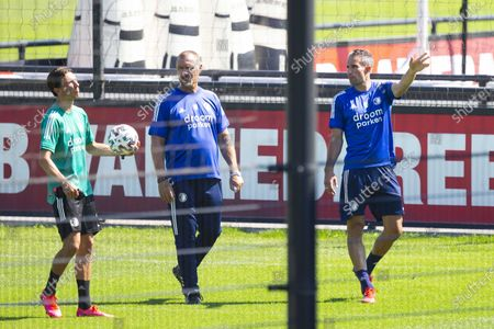 Stock Photo of Robin van Persie (R) with with Steven Berghuis (L) and John de Wolf at the Feyenoord's training complex in Rotterdam, the Netherlands, 07 August 2020. Van Persie, former player of the club, will join the Feyenoord technical staff for the 2020-2021 season and will train the strikers.