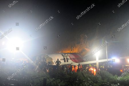 Stock Image of The Air India Express flight that skidded off a runway while landing at the airport in Kozhikode, Kerala state, India, . The special evacuation flight bringing people home to India who had been trapped abroad because of the coronavirus skidded off the runway and split in two while landing in heavy rain killing more than a dozen people and injuring dozens more