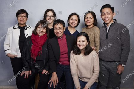 """Lilbeth Frondoso, from back left, producer Leah Marino, Chay Hofilena, Glenda Gloria, Rambo Talabong, writer/director Ramona S. Diaz, from bottom left, Maria Ressa and Pia Ranada pose for a portrait to promote the film """"A Thousand Cuts"""" during the Sundance Film Festival, in Park City, Utah. The documentary tracks Ressa's dual life in recent years. She's seen smiling while accepting international honors and praise from the likes of George Clooney, then grimly facing down online harassment, legal action and real world threats for her news site's reporting on the drug war waged by President Rodrigo Duterte"""