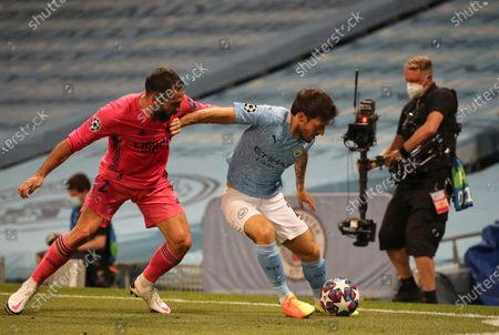 Real Madrid's Dani Carvajal, left, tries to stop Manchester City's David Silva, right, during the Champions League round of 16, second leg soccer match between Manchester City and Real Madrid at the Etihad Stadium in Manchester, England