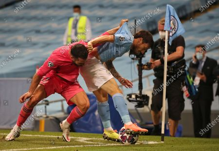 Real Madrid's Dani Carvajal, left, pulls the shirt of Manchester City's David Silva, right, during the Champions League round of 16, second leg soccer match between Manchester City and Real Madrid at the Etihad Stadium in Manchester, England