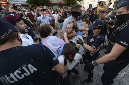 Police scuffle with pro-LGBT protesters angry at the arrest of an LGBT activist in Warsaw Poland on .The incident comes amid rising tensions in Poland between LGBT activists and a conservative government that is opposed to LGBT rights