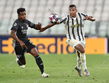 Juventus' Alex Sandro (R) in action against Lyon's Thiago Mendes during the UEFA Champions League round of 16 second leg soccer match Juventus FC vs Olympique Lyon at the Allianz Stadium in Turin, Italy, 07 August 2020.