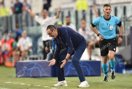 Juventus' coach Maurizio Sarri gestures during the UEFA Champions League round of 16 second leg soccer match Juventus FC vs Olympique Lyon at the Allianz Stadium in Turin, Italy, 07 August 2020.