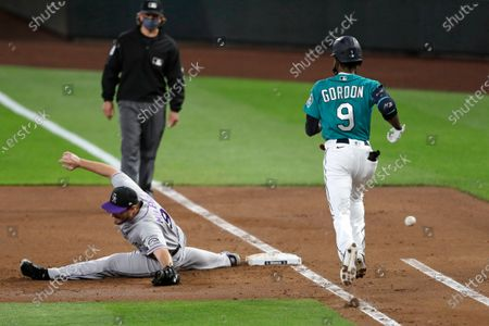 Colorado Rockies first baseman Daniel Murphy, front left, stretches but cannot reach an overthrow as Seattle Mariners' Dee Gordon, right, heads to first base on the error in the second inning of a baseball game, in Seattle. Rockies shortstop Trevor Story was charged with an error on the play