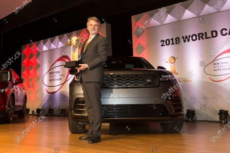 Dr. Ralf Speth CEO poses with trophy 2018 World car Design of the year for Land Rover Velar at 2018 New York International Auto Show at Jacob Javits Center