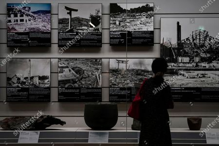 A visitor looks at photographs at the Nagasaki Atomic Bomb Museum in Nagasaki, southern Japan, 08 August 2020. Nagasaki is preparing to mark the 75th anniversary of the atomic bombing on 09 August as related events are either canceled or scaled down this year to avoid the spreading of the coronavirus and COVID-19 disease pandemic. In 1945 the United States dropped two nuclear bombs over the cities of Hiroshima and Nagasaki on 06 and 09 August respectively, killing more than 200,000 people.