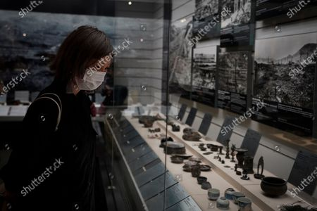 A visitor looks at war artifacts at the Nagasaki Atomic Bomb Museum in Nagasaki, southern Japan, 08 August 2020. Nagasaki is preparing to mark the 75th anniversary of the atomic bombing on 09 August as related events are either canceled or scaled down this year to avoid the spreading of the coronavirus and COVID-19 disease pandemic. In 1945 the United States dropped two nuclear bombs over the cities of Hiroshima and Nagasaki on 06 and 09 August respectively, killing more than 200,000 people.