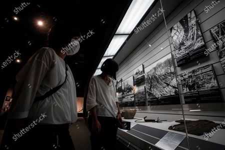 Visitors look at photographs at the Nagasaki Atomic Bomb Museum in Nagasaki, southern Japan, 08 August 2020. Nagasaki is preparing to mark the 75th anniversary of the atomic bombing on 09 August as related events are either canceled or scaled down this year to avoid the spreading of the coronavirus and COVID-19 disease pandemic. In 1945 the United States dropped two nuclear bombs over the cities of Hiroshima and Nagasaki on 06 and 09 August respectively, killing more than 200,000 people.
