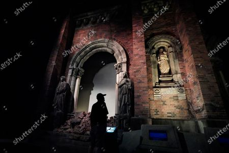 A visitor looks at a replica of the wall of the Urakami Cathedral which was located only some 500 meters from the hypocenter and was almost completely destroyed by the atomic bomb, at the Nagasaki Atomic Bomb Museum in Nagasaki, southern Japan, 08 August 2020. Nagasaki is preparing to mark the 75th anniversary of the atomic bombing on 09 August as related events are either canceled or scaled down this year to avoid the spreading of the coronavirus and COVID-19 disease pandemic. In 1945 the United States dropped two nuclear bombs over the cities of Hiroshima and Nagasaki on 06 and 09 August respectively, killing more than 200,000 people.