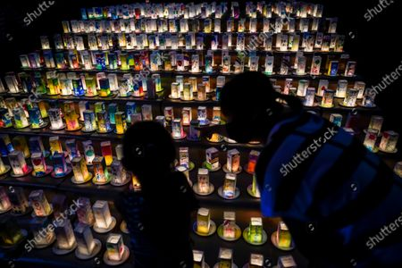 A young girl with her mother looks at hundreds of lanterns with messages of peace at the Peace Park in Nagasaki, southern Japan, 08 August 2020. Nagasaki is preparing to mark the 75th anniversary of the 1945 atomic bombing on 09 August as related events are either canceled or scaled down this year to avoid the spreading of the coronavirus disease (COVID-19) pandemic. In 1945 the United States dropped two nuclear bombs over the cities of Hiroshima and Nagasaki on 06 and 09 August respectively, killing more than 200,000 people.