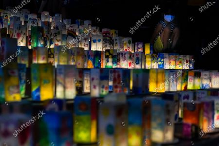 A young girl looks at hundreds of lanterns with messages of peace displayed at the Peace Park in Nagasaki, southern Japan, 08 August 2020. Nagasaki is preparing to mark the 75th anniversary of the 1945 atomic bombing on 09 August as related events are either canceled or scaled down this year to avoid the spreading of the coronavirus disease (COVID-19) pandemic. In 1945 the United States dropped two nuclear bombs over the cities of Hiroshima and Nagasaki on 06 and 09 August respectively, killing more than 200,000 people.