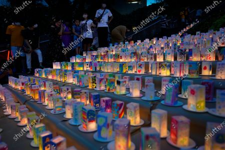 People look at hundreds of lanterns with messages of peace at the Peace Park in Nagasaki, southern Japan, 08 August 2020. Nagasaki is preparing to mark the 75th anniversary of the 1945 atomic bombing on 09 August as related events are either canceled or scaled down this year to avoid the spreading of the coronavirus disease (COVID-19) pandemic. In 1945 the United States dropped two nuclear bombs over the cities of Hiroshima and Nagasaki on 06 and 09 August respectively, killing more than 200,000 people.