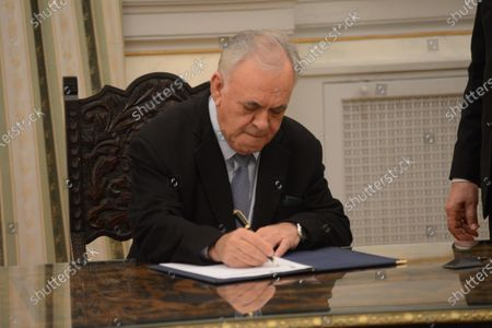 New Minister of Economy and Development, Giannis Dragasakis, who remains also the Deputy Prime Minister, puts his signature after his political oath.