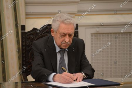 New Deputy Minister of National Defence Fotis kouvelis,puts his signature after his political oath.