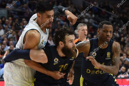 Gustavo Ayón (left), #14 of Real Madrid, Luigi Datome, #70 of Fenerbahce (center) and James Nunnally, #21 of Fenerbahce pictured during the 2017/2018 Turkish Airlines EuroLeague Regular Season Round 24 game between Real Madrid and Fenerbahce Dogus Istanbul at WiZink center in Madrid.