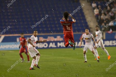Luis Ovalle (4) of CD Olimpia of Honduras jumps for air ball during 2018 CONCACAF Champions League round of 16 game against New York Red Bulls at Red Bull arena, Red Bulls won 2 - 0