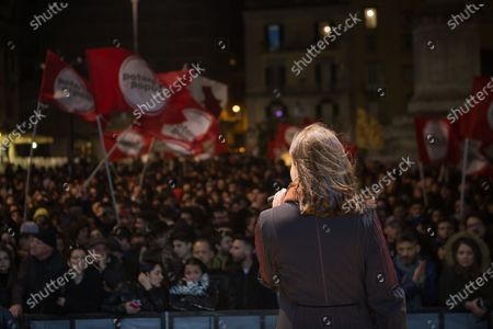 """Stock Photo of Italian actress and comedian Sabina Guzzanti speaks on stage of Dante's square during last day of election campaign for the new born left wing italian party """"Potere al Popolo""""."""