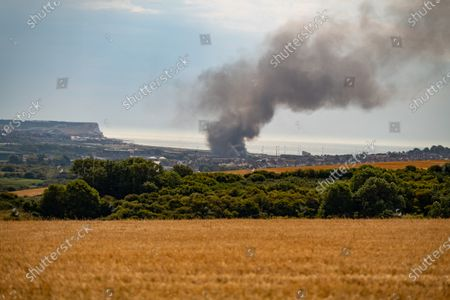Fire at a fisheries warehouse at the Port of Newhaven. Houses and industrial units have been evacuated dueto toxic fumes. Newhaven ,East Sussex, Brighton