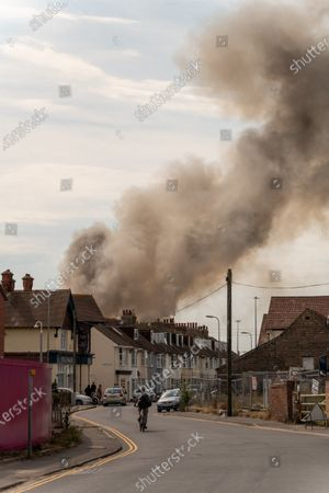 Stock Image of Fire at a fisheries warehouse at the Port of Newhaven. Houses and industrial units have been evacuated dueto toxic fumes. Newhaven ,East Sussex, Brighton