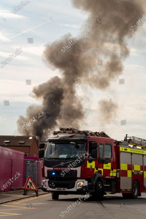 Stock Photo of Fire at a fisheries warehouse at the Port of Newhaven. Houses and industrial units have been evacuated dueto toxic fumes. Newhaven ,East Sussex, Brighton