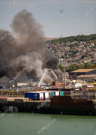 Firemen tackle fire at a fisheries warehouse at the Port of Newhaven. Houses and industrial units have been evacuated dueto toxic fumes. Newhaven ,East Sussex,UK
