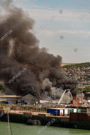 Fire at a fisheries warehouse at the Port of Newhaven. Houses and industrial units have been evacuated dueto toxic fumes. Newhaven ,East Sussex,UK