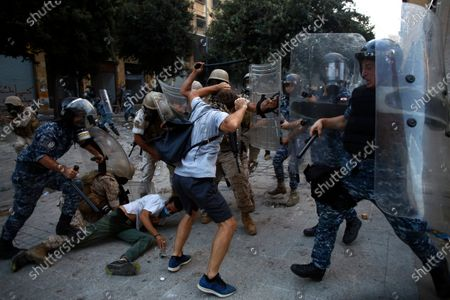 Protesters clash with police during a protest against the political elites and the government after this week's deadly explosion at Beirut port which devastated large parts of the capital in Beirut, Lebanon
