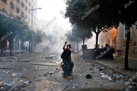 Protester gestures during clashes with police as part of a protest against the political elites and the government after this week's deadly explosion at Beirut port which devastated large parts of the capital in Beirut, Lebanon