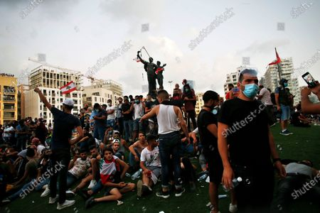 Demonstrators gather at Martyrs Square to protest against the political elites and the government after this week's deadly explosion at Beirut port which devastated large parts of the capital in Beirut, Lebanon