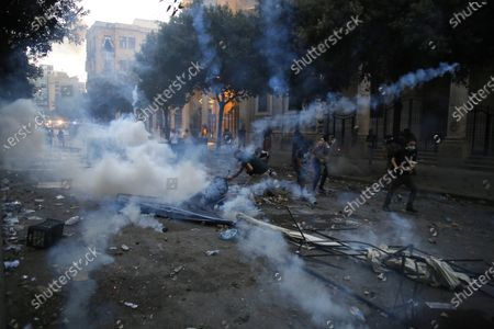 Protestors clash with police during a protest against the political elites and the government after this week's deadly explosion at Beirut port which devastated large parts of the capital in Beirut, Lebanon