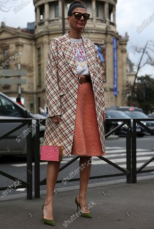 Stock Picture of PARIS- 06 March 2018 Giovanna Battaglia Engelbert on the street before the Miu Miu show during the Paris Fashion Week