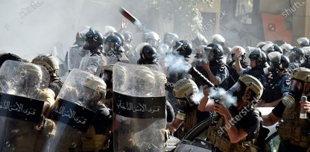 Riot police fire tear gas against anti-government protesters during a protest outside of the Lebanese Parliament in Beirut, Lebanon, 08 August 2020. People gathered for the so-called 'the Saturday of the hanging ropes' to protest against the political leaders and calling on those responsible over the explosion to be held accountable. Lebanese Health Ministry on 07 August said at least 154 people were killed, and more than 5,000 injured in the Beirut blast that devastated the port area on 04 August and believed to have been caused by an estimated 2,750 tons of ammonium nitrate stored in a warehouse.