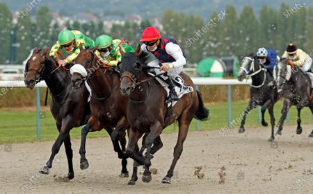 Stock Picture of BLACK PRINCESS (centre, Maxime Guyon) beats MAJOR SALSA (2nd left) and STORMING OUT (left) in The Prix Cavalassur Deauville